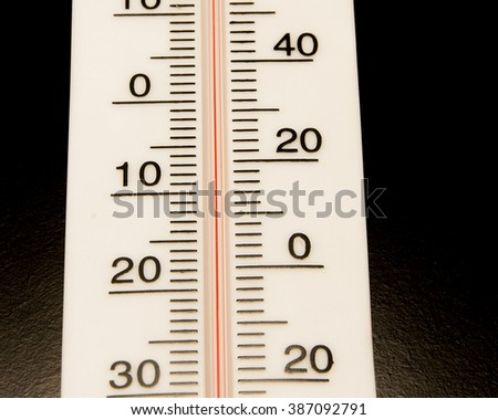 Basic weather instrument on black background/Thermometer/White temperature meter on black background - stock photo