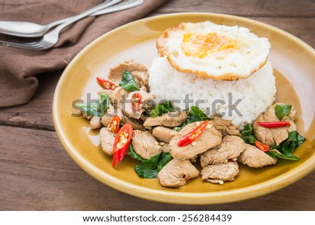 Basil fried rice with chicken and fried egg (Pad kra prao kai), Thai food  - stock photo