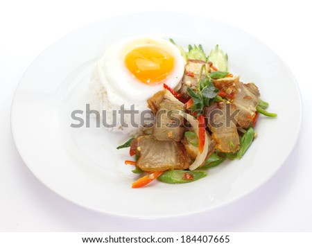 Basil fried rice with pork in white dish
