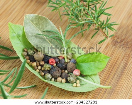basil's leaf with spices on wooden plank - stock photo