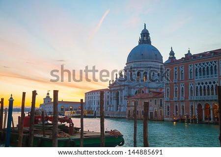 Basilica Di Santa Maria della Salute with vaporetto floating at Grand canal - stock photo