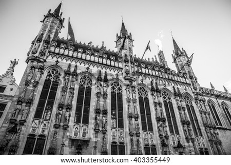 Basilica of Holy Blood at evening time in Bruges, Belgium. Black-white photo.