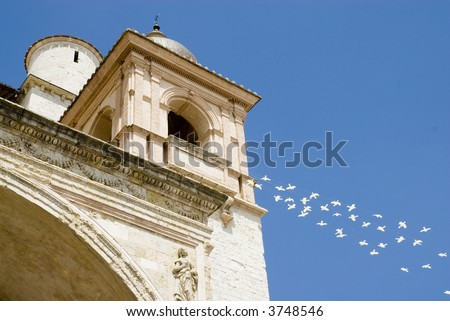 Basilica of Saint Francis in Assisi with doves as a symbol of peace - stock photo