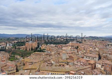 Basilica of San Domenico (Basilica Cateriniana), a basilica church in Siena, Tuscany, Italy. View from the Campanile del Mangia. - stock photo