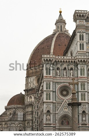Basilica of Santa Maria del Fiore or Basilica of Saint Mary of the Flower in Florence, Italy. Side view at cloudy day. - stock photo