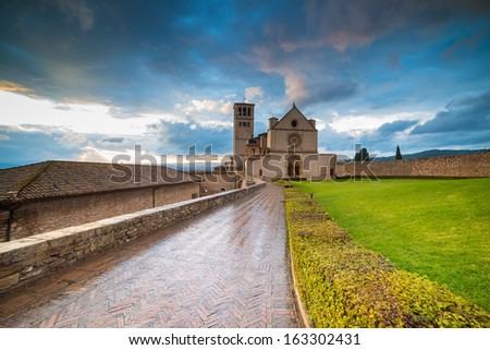 Basilica of St. Francis in Assisi.Target of innumerable pilgrims from all the world which admire the grave of St. Francis in the church. - stock photo