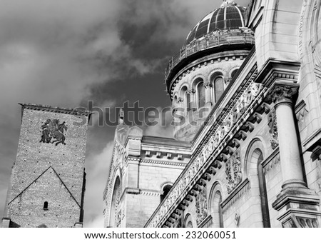 Basilica of St Martin and Charlemagne tower (remaining of huge early medieval basilica) at backgrounds in the old center of the city of Tours. (Val de Loire, France) Aged photo. Black and white. - stock photo