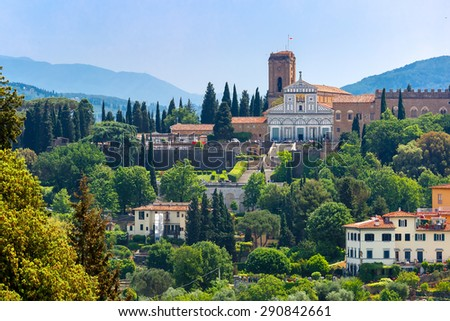 Basilica San Miniato al Monte on the south bank of the River Arno, at morning from Palazzo Vecchio in Florence, Tuscany, Italy - stock photo