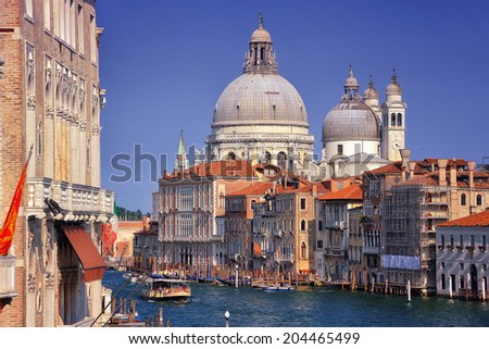 Basilica Santa Maria della Salute - a Roman Catholic church located at Grand Canal in Venice, Italy. It is an emblem of the city and a famous touristic landmark - stock photo