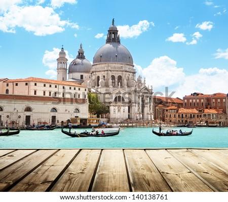 Basilica Santa Maria della Salute, Venice, Italy and wooden surface - stock photo