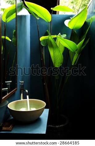 Basin in green bathroom - stock photo