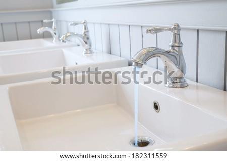 Basin in washroom - stock photo