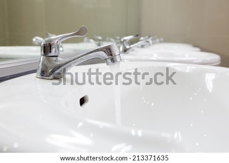 Basin in washroom interior  - stock photo