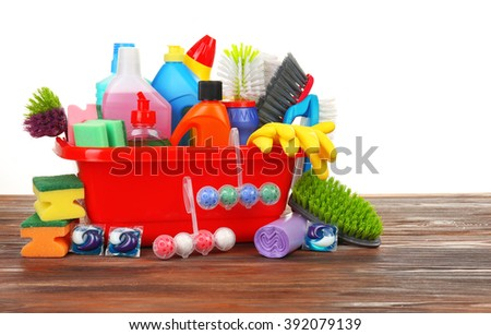 Basin of cleaning supplies on the floor - stock photo