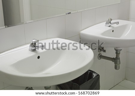 Basin white marble bathroom and faucets - stock photo