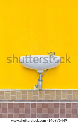 basin white on Wall yellow - stock photo