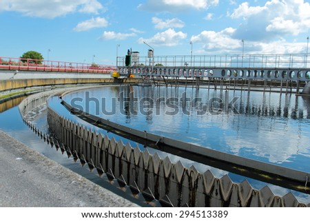 Basin with cleaning water in treatment plant - stock photo