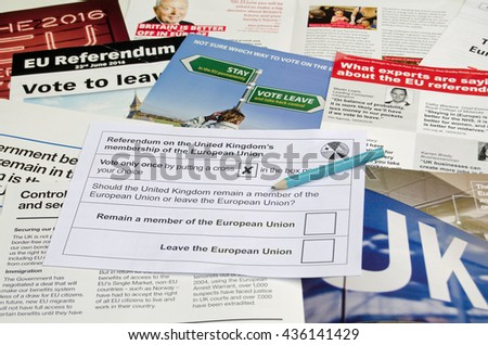 BASINGSTOKE, UK - JUNE 13, 2016:  EU Referendum ballot paper on top of literature from campaigns both to leave and remain in the European Union.