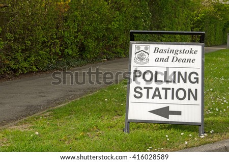 BASINGSTOKE, UK - MAY 5, 2016:  A sign pointing towards a polling station in the Hampshire borough of Basingstoke and Deane on election day. - stock photo