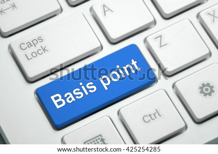 Basis point text written on Blue button White Keyboard