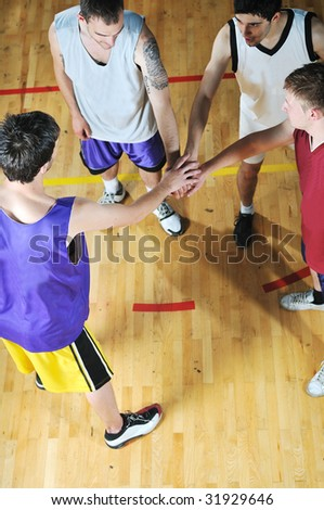 basket ball players team portrait in hi-school sport gymbasket ball players team portrait in hi-school sport gym - stock photo