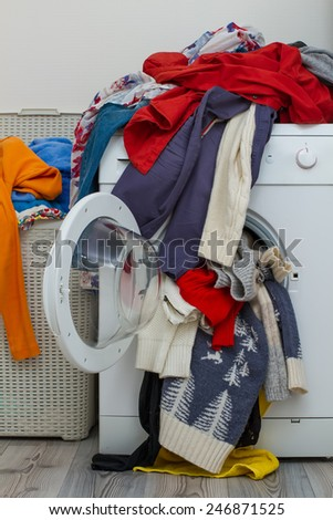 basket dirty laundry and wash machine in the bathroom - stock photo
