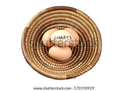 Basket Egg Investing in Shares  - stock photo