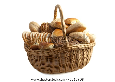 Basket filled with bread isolated over white - stock photo