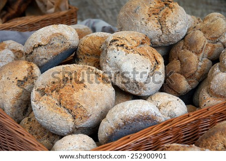basket filled with freshly baked bread buns  - stock photo