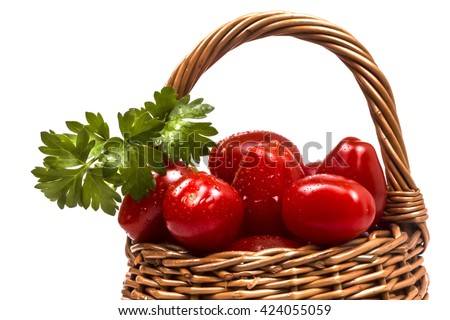 basket filled with small pets tomato with a sprig of parsley