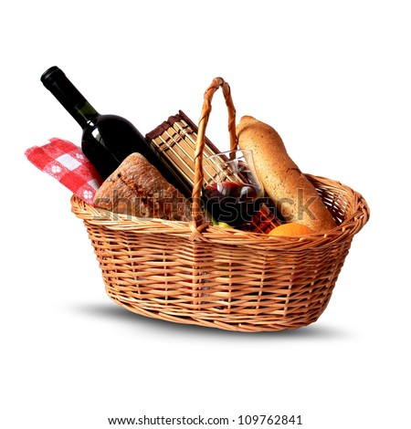 basket for picnic with wine, bread, fruits and picnic blanket - stock photo