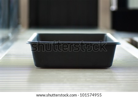 basket for security control at the airport - stock photo