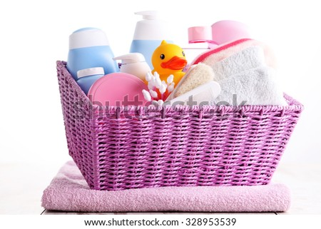 basket full of baby accessories - baby stuff - stock photo
