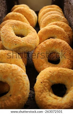 Basket full of  cheese bagels with shallow dept of field - stock photo