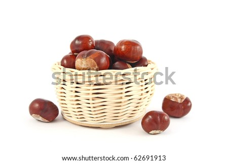 Basket full of chestnuts on white background