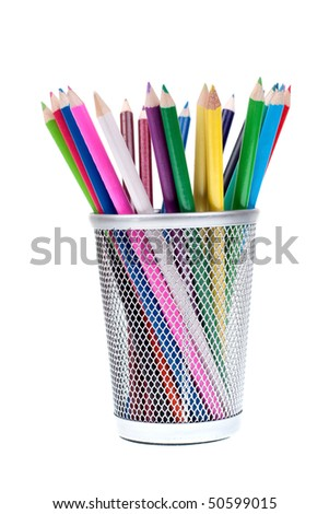 Basket full of crayons isolated on white background