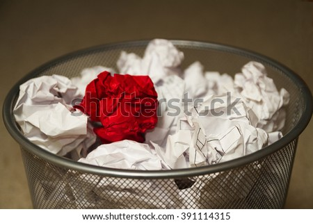 Basket full of crumpled paper. Red lump. business background - stock photo