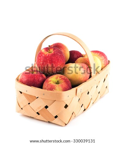 Basket full of delicious red apples, on white