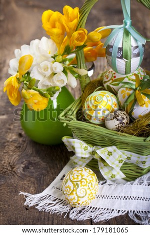 Basket full of Easter eggs - stock photo