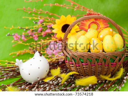Basket full of Easter eggs and flower - stock photo