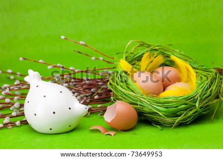 Basket full of Easter eggs with chicken - stock photo