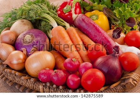 Basket full of fresh, nutritious and delicious vegetables - stock photo