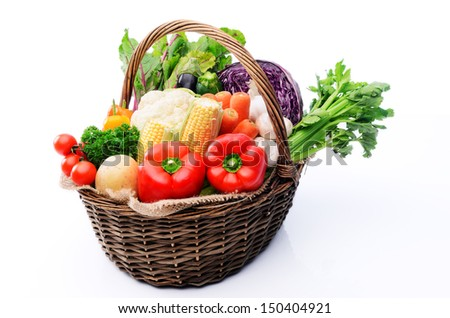 Basket full of fresh summer organic produce vegetables from the farmers market, tomatoes, peppers, capsicums, celery, cabbage, cauliflower, mushroom, leafy greens - stock photo
