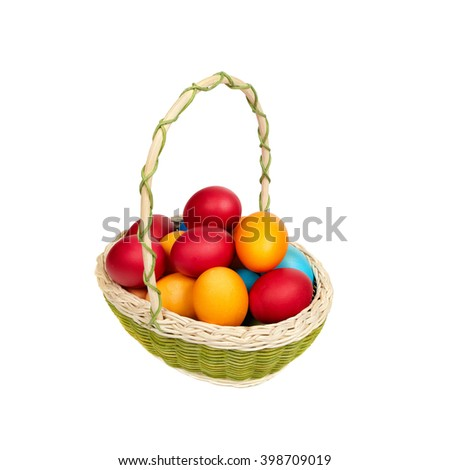 Basket full of hand-painted Easter eggs standing on a wooden surface. isolated on a white background