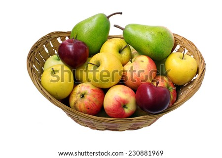 Basket full of ripe pears and apples - stock photo