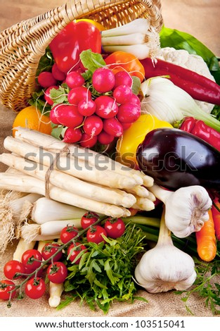 Basket full of various fresh organic vegetables from the garden - stock photo