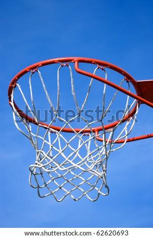 Basket hoop against blue sky - stock photo