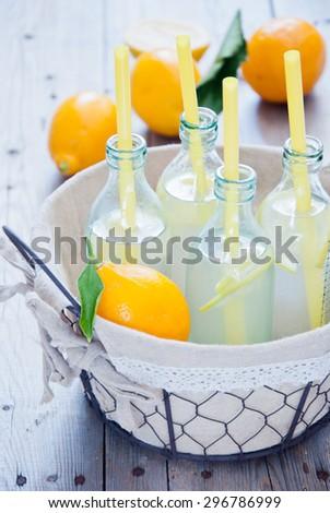 Basket lemon lemonade bottles - stock photo
