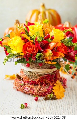basket of autumn flowers for holiday - stock photo