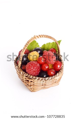 basket of berries isolated on white background